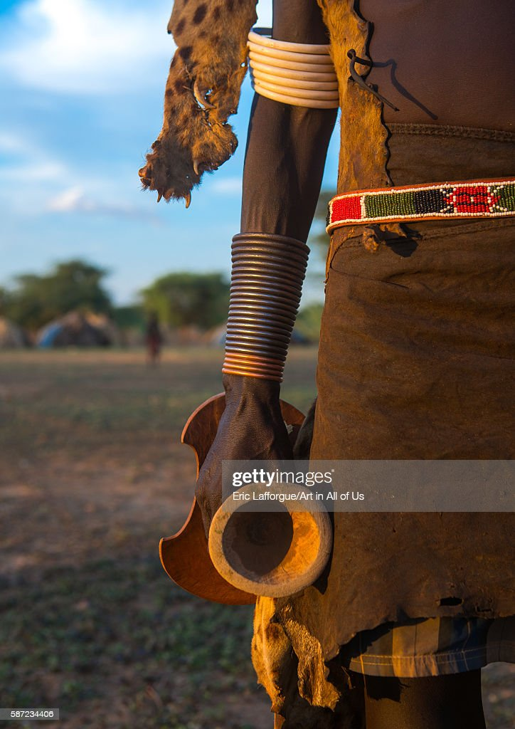 Dassanech man with his wooden pillow during dimi ceremony to celebrate circumcision of the teenagers omo valley omorate Ethiopia on March 20 2016 in...