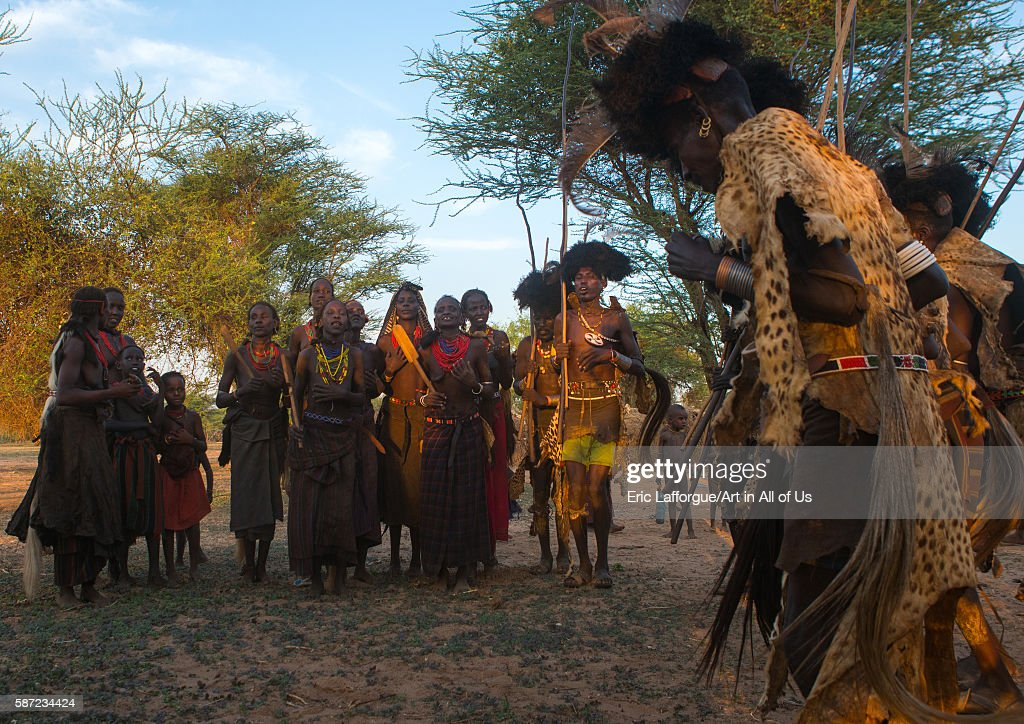 Dassanech men and women during dimi ceremony to celebrate circumcision of teenagers omo valley omorate Ethiopia on March 20 2016 in Omorate Ethiopia