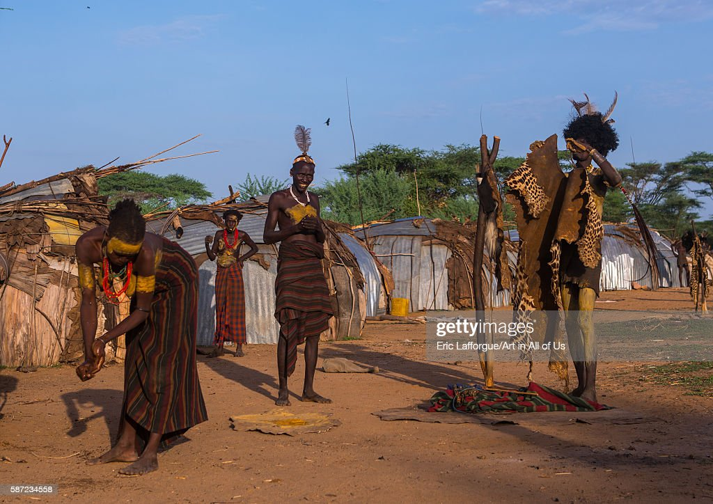 Dassanech men put on leopard skins and ostrich feathers headdresses to join dimi ceremony to celebrate circumcision of teenagers omo valley omorate...