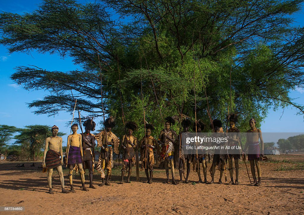 Dassanech men with leopard skins and ostrich feathers headwears during dimi ceremony to celebrate circumcision of teenagers omo valley omorate...