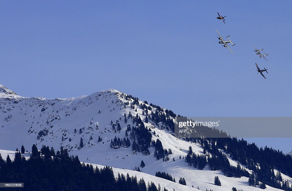 A Dassault Aviation Alpha-Jet (L), a historic World War II North American B-25 Mitchell bomber (2L), a Lockheed P-38 Lightning and a Chance Vought F4 Corsair (R) fly over the Kitzbuehlel Alps during an exhibition on January 27, 2013 in Kitzbuehel, Austria.