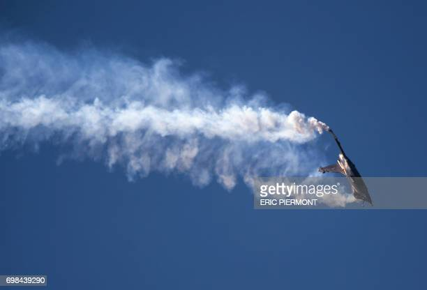A Dassault Aviation Rafale fighter aircraft performs its flying display during the International Paris Air Show in Le Bourget north of Paris on June...
