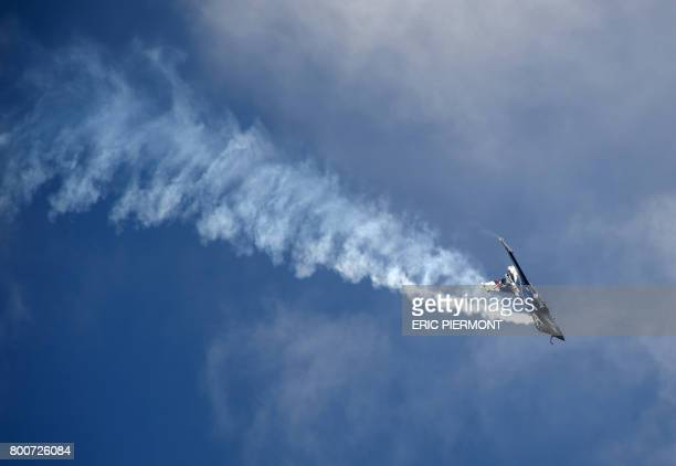 A Dassault Aviation Rafale jet performs a flight display on the last day of the International Paris Air Show on June 25 2017 at Le Bourget Airport...