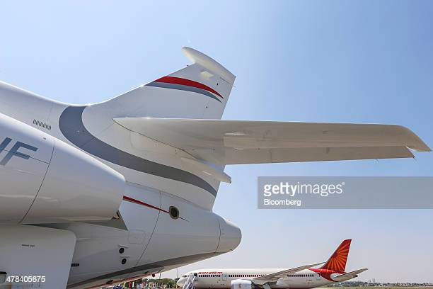 A Dassault Aviation SA Falcon 7X aircraft left sits on display during the India Aviation 2014 air show held at the Begumpet Airport in Hyderabad...
