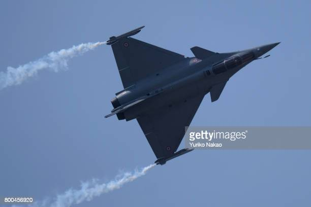 Dassault Rafale performs an aerial demonstration over the Le Bourget Airport during the 52nd International Paris Air Show on June 22 in Paris France