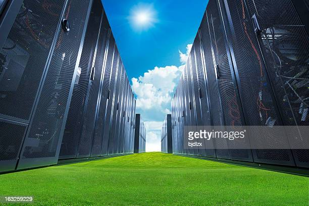 A data center with servers on green grass and a blue sky