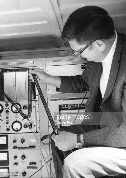 Data comes out in the form of punched darkcolored tape held by Dr George V Keller inside one of the two panel trucks Probe signals are easy to read...