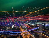 Data lines over city skyline