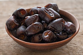 Date fruit on wooden background, close up
