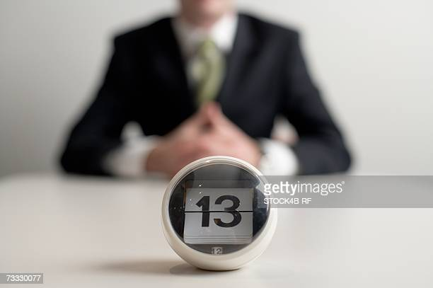 A date indicator, a businessman sitting in the background