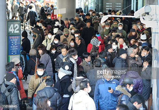 DATELINEPeople crowd at a longdistance bus terminal in front of Sendai Railway Station to leave the earthquake and tsunamihit town of Sendai Miyagi...