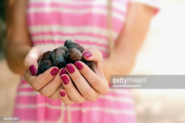 Dates in palm of hand
