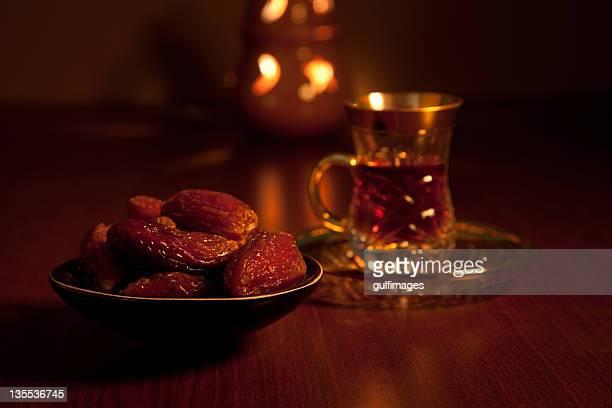 Dates with tea and illuminated lantern