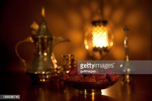 Dates with tea set, rosewater sprinkler and illuminated lantern
