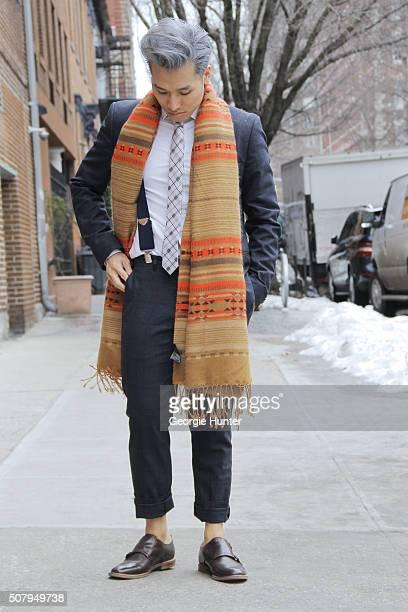 Dathias Godfrey seen at Industria Superstudios wearing brown Aldo shoes grey Tiger Of Sweden suit Topman white shirt and tie vintage braces and...