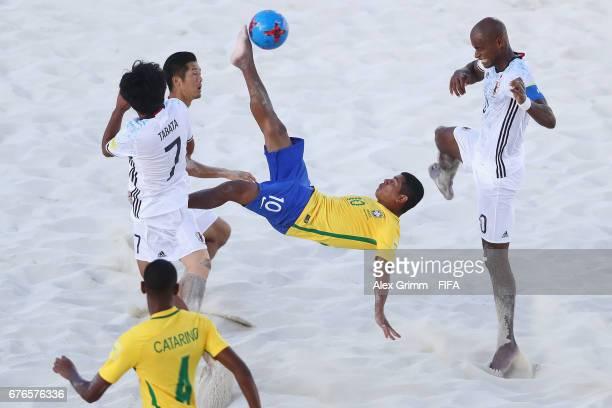 Datinha of Brazil attempts a bicycle kick between Teruki Tabata Takaaki Oba and Ozu Moreira of Japan during the FIFA Beach Soccer World Cup Bahamas...