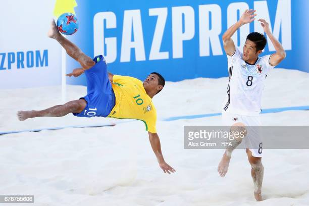 Datinha of Brazil attempts a bicycle kick next to Takaaki Oba of Japan during the FIFA Beach Soccer World Cup Bahamas 2017 group D match between...
