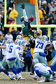 Datone Jones of the Green Bay Packers tips the football on a Dallas Cowboys field goal during the 2015 NFC Divisional Playoff game at Lambeau Field...
