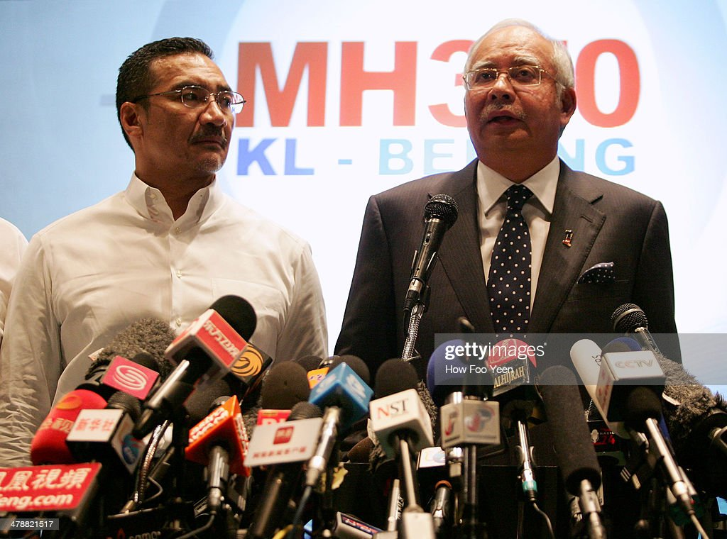 Datuk Hishammuddin Hussein (L), acting Minister of Transport and Malaysian Prime Minister Najib Abdul Razak update the media on the search and rescue plan for the missing MAS Airlines flight MH370 during a press conference on March 15, 2014 in Kuala Lumpur, Malaysia. During the press conference the Prime Minister said that investigators had discovered evidence from satellite and radar systems indicating that the communication systems of the aircraft had been intentionally disabled. The search for the plane in the South China Sea has now been abandoned with the focus switching to two flight corridors, the first stretching from the border of Kazakhstan and Turkmenistan to northern Thailand and a second stretching from Indonesia to the South Indian Ocean.The missing aircraft was carrying 227 passengers and 12 crew.