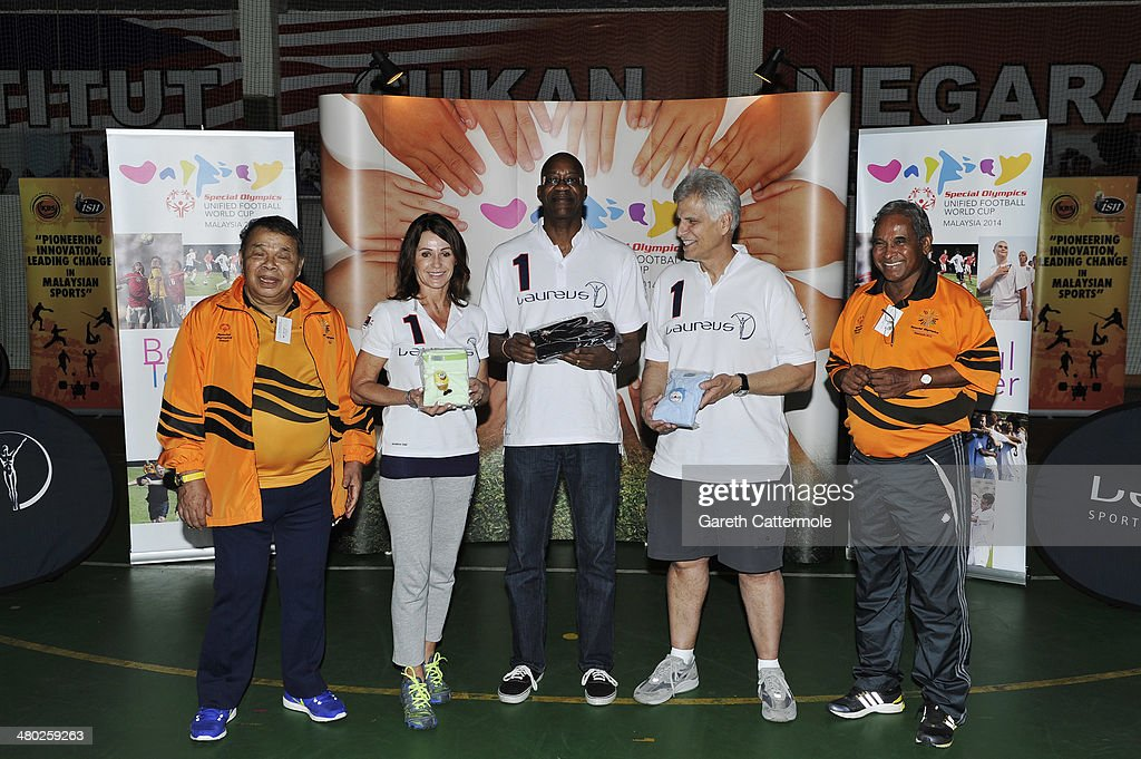 Datuk Muhammad Feisol Hassan President of the Special Olympics Malaysia with Laureus Academy Member Nadia Comaneci Laureus Academy Chairman Edwin...