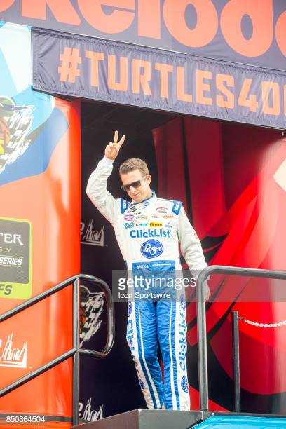 Daugherty Racing Kroger ClickList Chevy driver AJ Allmendinger waves to the fans during the Monster Energy Cup Series Tale of the Turtles 400 driver...