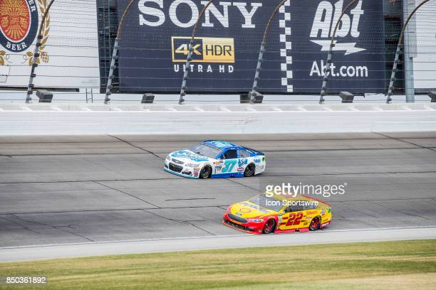 Daugherty Racing Scott Products Chevy driver Chris Buescher and Team Penske Shell Pennzoil Ford driver Joey Logano during the Monster Energy Cup...