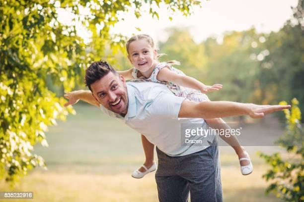 Daughter and dad doing piggyback