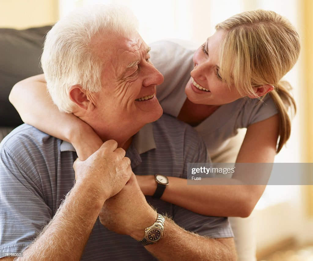 Daughter and Father Embracing : Stock Photo