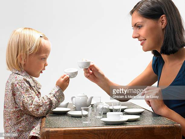 Daughter and mother having tea