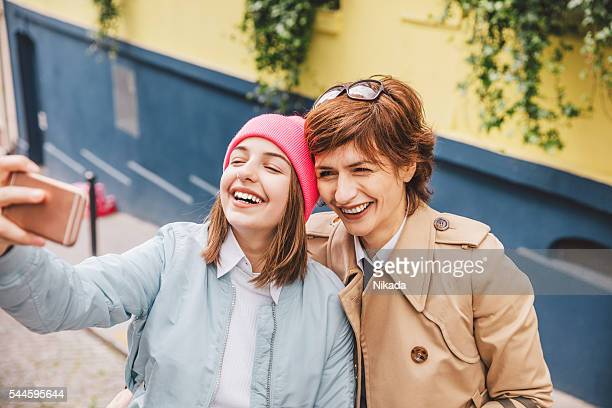 Daughter and Mother taking selfie in Paris streets