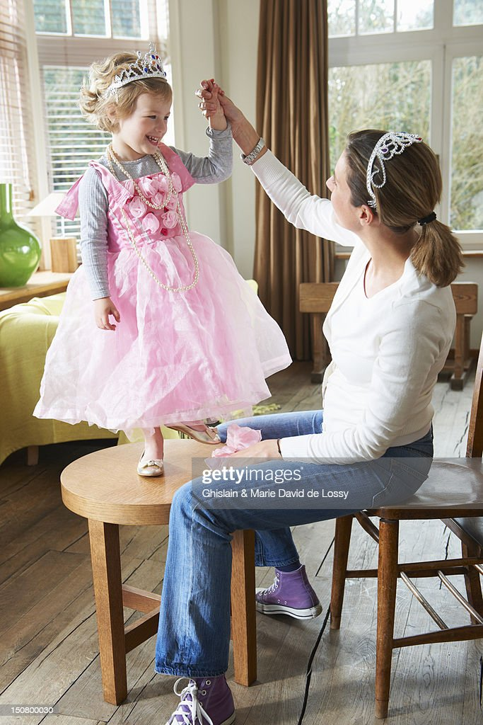 Daughter dressed up as a princess, with mother : Stock Photo
