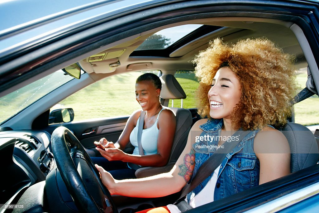 Daughter driving mother in car