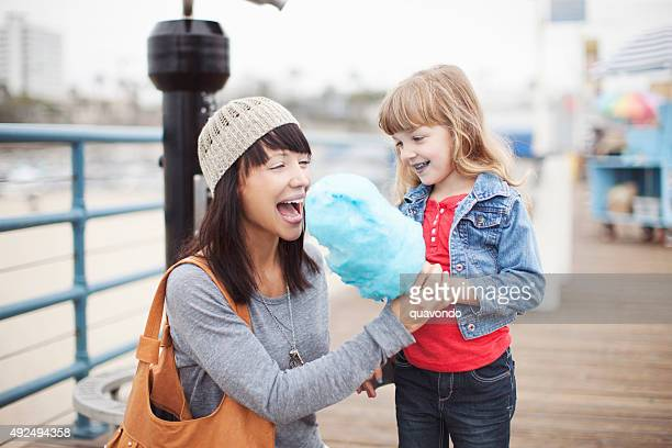Daughter Feeding Mom Cotton Candy at Beach