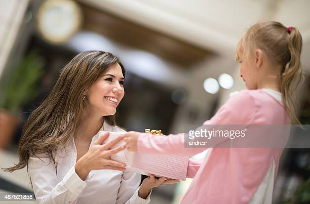 Daughter giving a gift to her mother