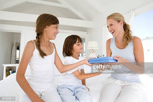 Daughter giving a present to her mother