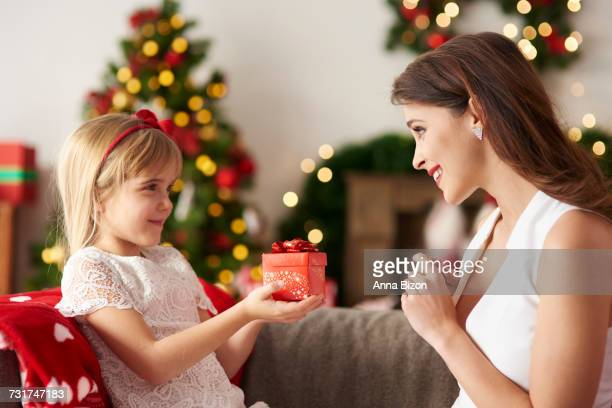 Daughter handing over gift for mummy. Debica, Poland