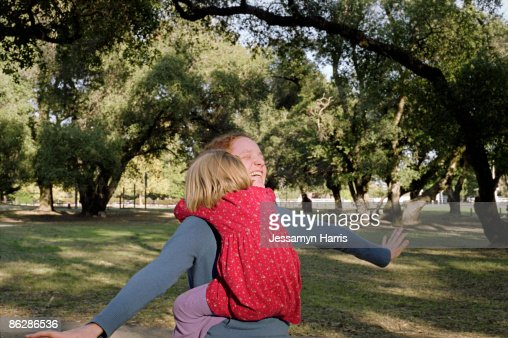 Daughter hugging mother : Stock Photo