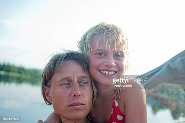 Daughter hugging mother, Siljan, Dalarna, Sweden