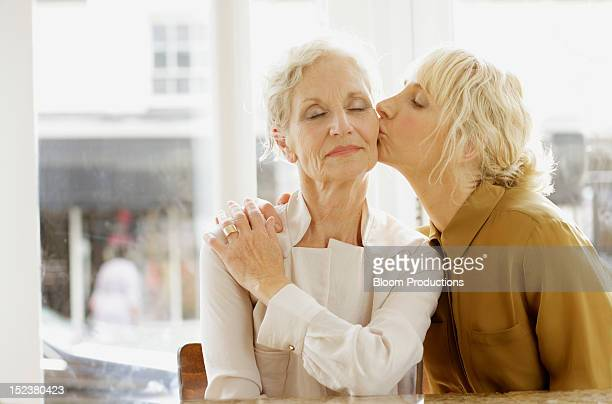 daughter kissing a mother