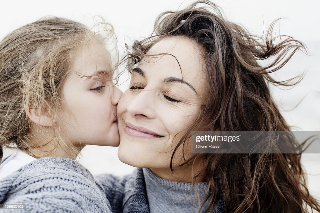 Daughter kissing mother outdoors : Stock-Foto