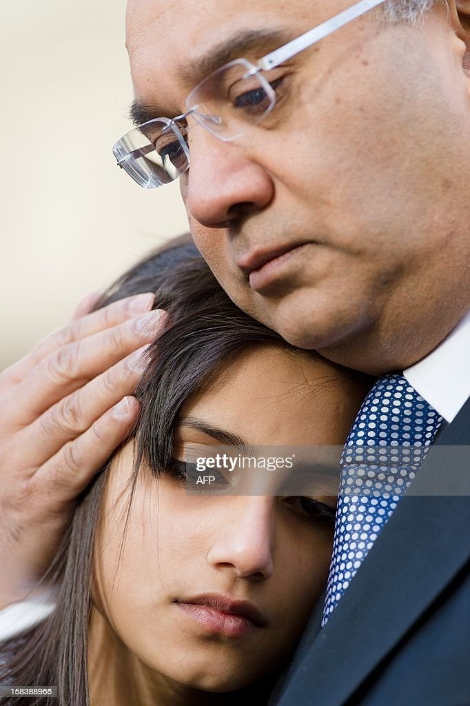 Daughter of late nurse Jacintha Saldanha, Lisha Saldanha is consoled by Member of Parliament Keith Vaz as her family read statements to media representatives outside Westminster Cathedral in central London following a service of Thanksgiving for the life of Jacintha Saldanha on December 15, 2012. The children of a nurse found hanged after she was duped by a hoax phone call to the hospital treating Prince William's wife Catherine told a mass in her memory her death left 'an unfillable void'. Indian-born Jacintha Saldanha, 46, apparently killed herself in nurses' accommodation at King Edward VII's Hospital in London last week.