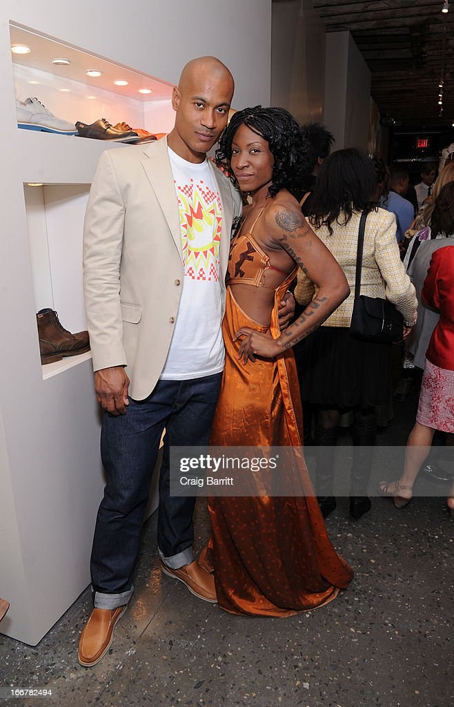 Daughter of late United Nations Ambassador and celebrity activist Africa Engo poses with super model and actor Max Tapper (L) at the Pikolinos pop up store opening celebrating the Maasai Project with Juan Peran and Olivia Palermo on April 16, 2013 in New York City.
