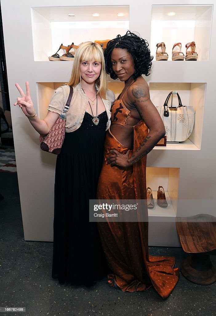 Daughter of late United Nations Ambassador and celebrity activist Africa Engo poses with Radio Host and Lead singer of 'Tomorrows Friend' Alessandra Iavarone (L) at the Pikolinos pop up store opening celebrating the Maasai Project with Juan Peran and Olivia Palermo on April 16, 2013 in New York City.