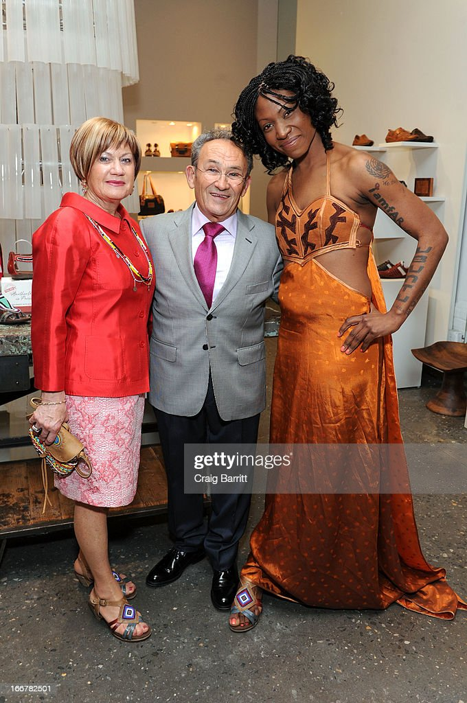 Daughter of late United Nations Ambassador and celebrity activist Africa Engo poses with Juan Peran at the Pikolinos pop up store opening celebrating the Maasai Project with Juan Peran and Olivia Palermo on April 16, 2013 in New York City.