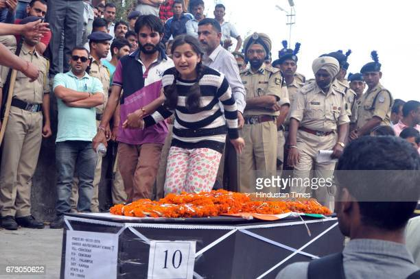 Daughter of martyr Sanjay Kumar who was killed in Maoist attack in Sukma Chhattisgarh wails near his body during his funeral at his native village...