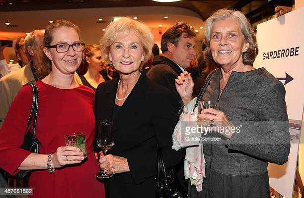 Daughter of Susi Hoeness Sabine Stuehler Karin Stoiber Susi Hoeness attend the Hirmer store reopening on October 22 2014 in Munich Germany