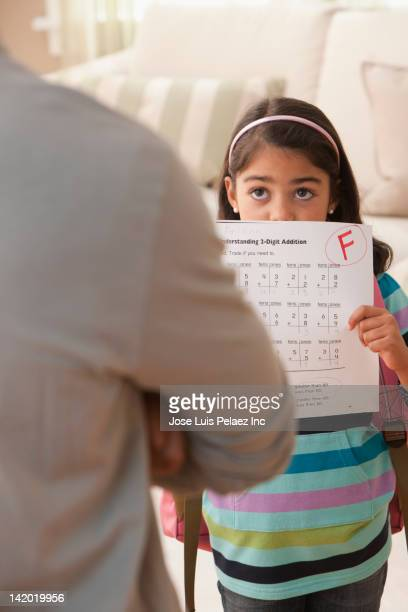 Daughter showing father her test score