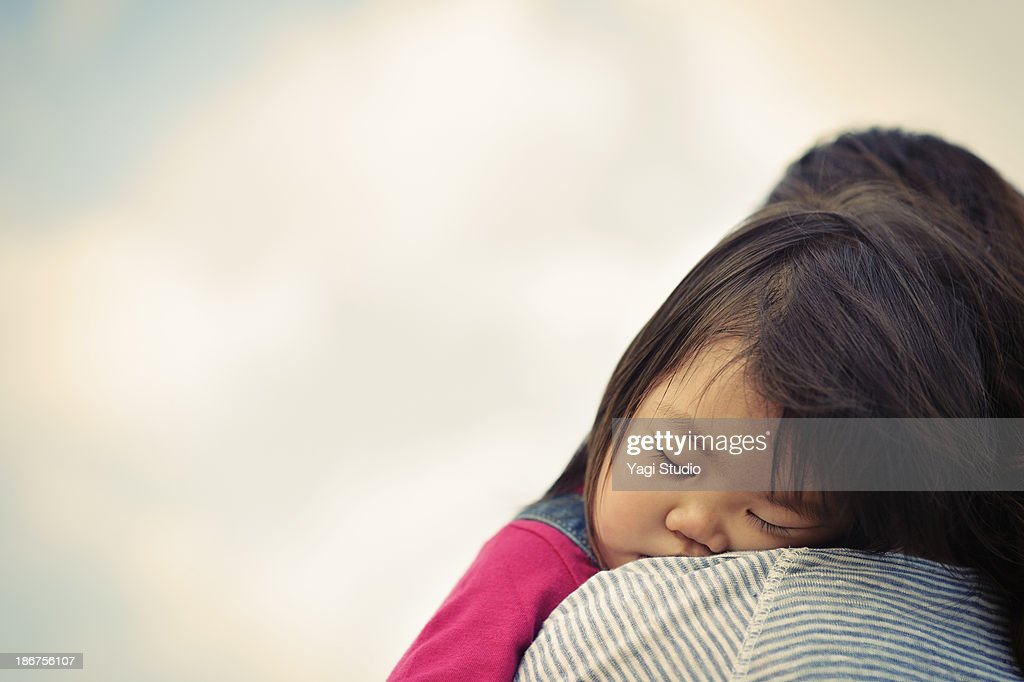 Daughter sleep is huggy to mother : Stock Photo