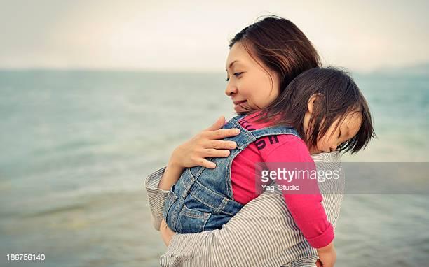 Daughter sleep is huggy to mother