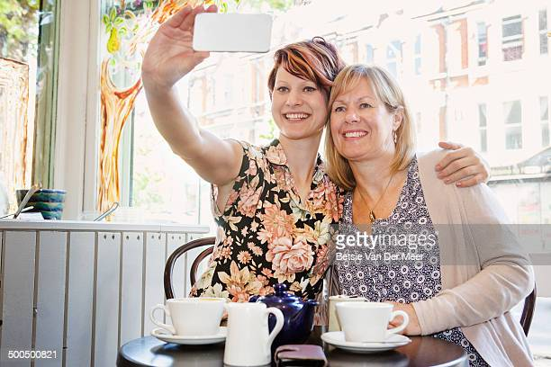 daughter taking selfie of mother and herself.